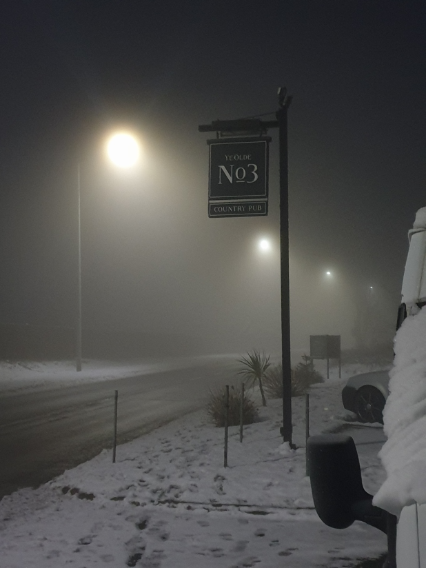 Sign at night in snow