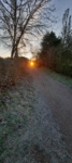 Sun setting at the end of a path